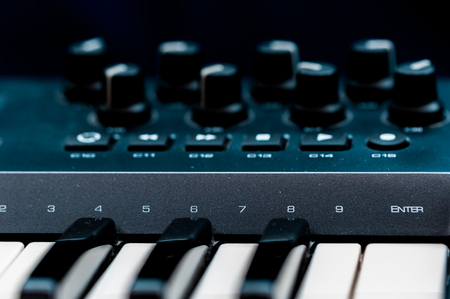 blak white: piano keys. close-up frontal view of keyboard blak and white Stock Photo