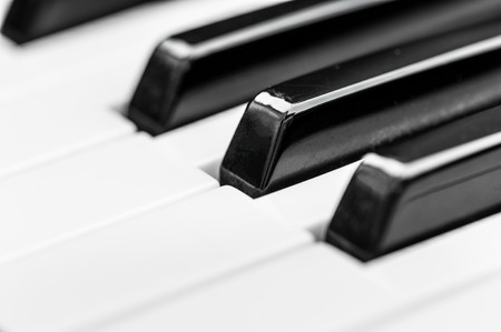 piano keys. close-up frontal view of keyboard blak and white Фото со стока