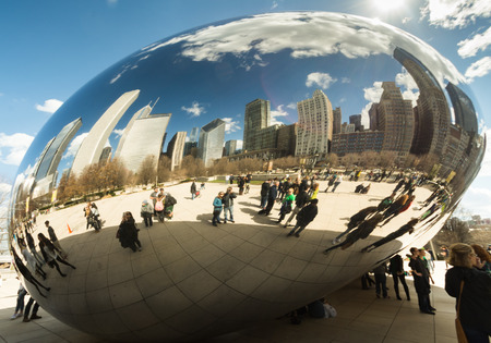 march 17: CHICAGO - MARCH 17: Cloud Gate in Millennium Park on March 17, 2016 in Chicago. The Cloud Gate (bean) is a major tourist attraction in Chicago Editorial