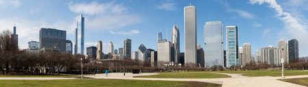hancock building: Chicago skyline panorama with skyscrapers over Lake Michigan with cloudy blue sky. Stock Photo