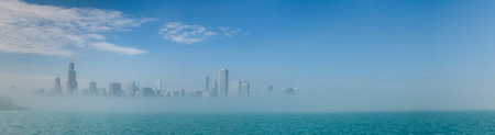lake michigan: Chicago skyline panorama with skyscrapers over Lake Michigan with cloudy blue sky. Stock Photo