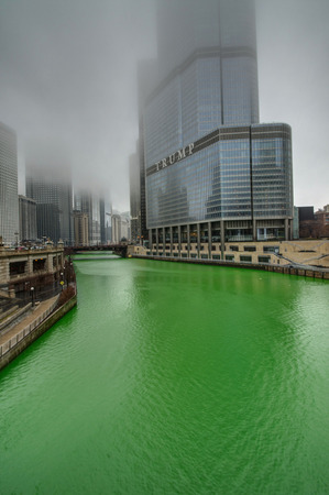 observers: CHICAGO - MARCH 13: Dyeing the Chicago River on St. Patricks day, on Mar 13, 2016 in Chicago, IL Editorial