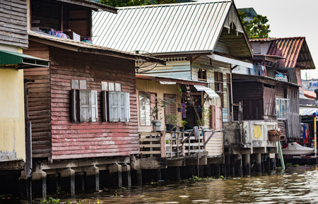 encroach: Slum on dirty canal Bangkok Thailand Stock Photo