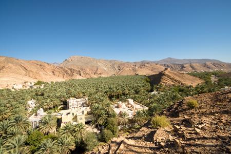 Oasis Panorama Omani Mountains at Jabal Akhdar in Al Hajar Mountains, Oman at sunset. Stock Photo