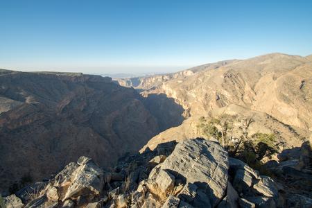Omani Mountains at Jabal Akhdar in Al Hajar Mountains, Oman at sunset. Stock Photo