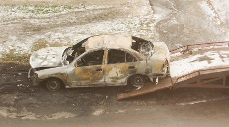 Burned car loaded on a tow truck photo