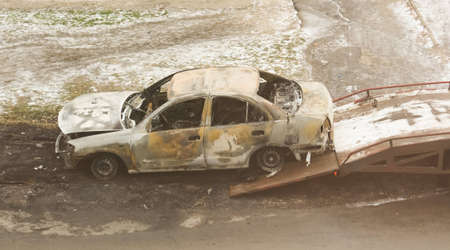Burned car loaded on a tow truck
