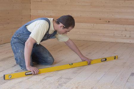 Carpenter checks the accuracy of the sub-floor horizon