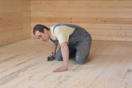 Carpenter Planed pine floors rough planer Stock Photo