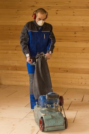 Carpenter prepare subfloor for laying parquet.