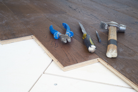 Tool for parquet flooring in the room: a hammer, dobojnik, chisel. Stock Photo