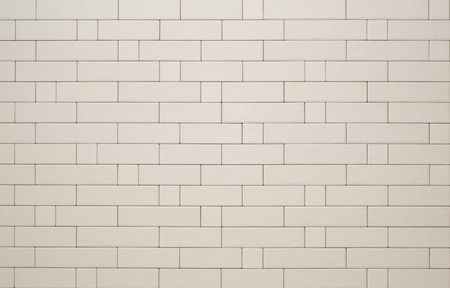 Texture of beige ceramic wall tile, stylized brick.