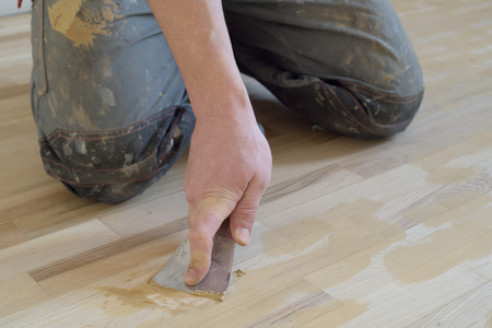 Work puttied old oak parquet acrylic putty. Stock Photo