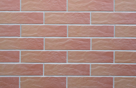 Texture in the form of ceramic tiles with imitation of brickwork. Stock Photo