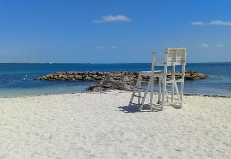 Chair on white sand on the beach in Nassau Bahamas. Stock Photo - 123741978
