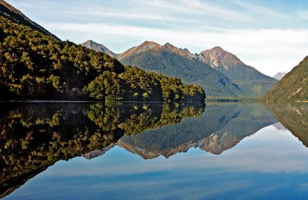 Reflections with New Zealand mountains and lake