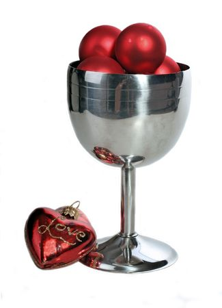 Red Christmas decorations in a silver globlet