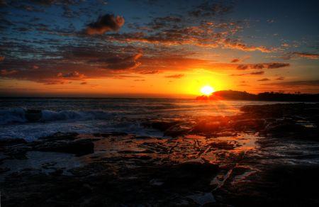Early Sunrise by the Coastline Stock Photo