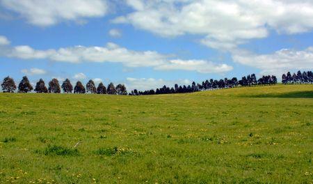 Countryside against cloudy blue sky