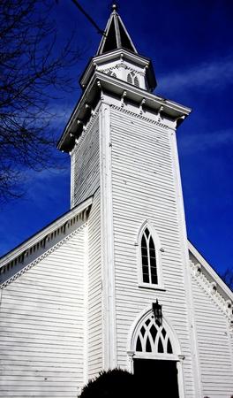 A white church against blue sky Stock Photo - 8325870