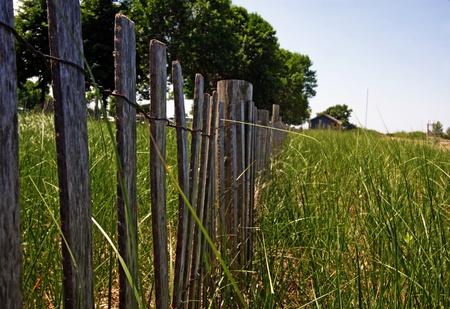 a fence along the beach