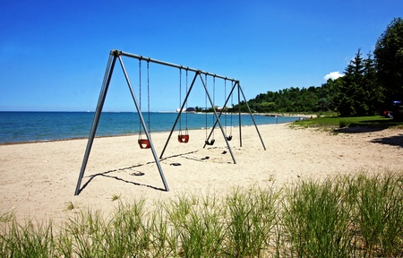 Swingset by the lake in summer