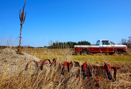 a landscape view of farmland with vintage truck