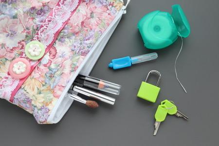 toothbrush,floss,tablets lock and key,toiletries bag