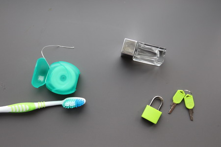 from home .toothbrush,floss,tablets lock and key aftershave