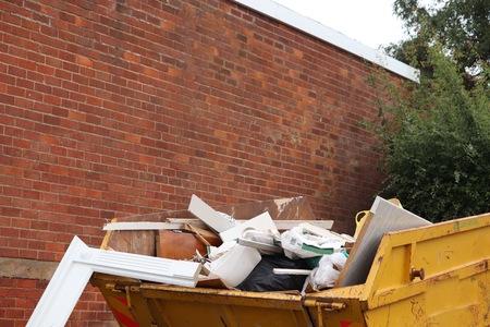 metal skip full of trash junk house clearance