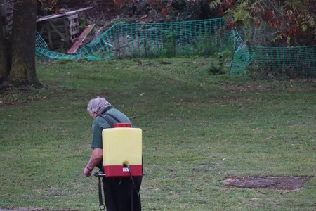 man using back pack of herbicides
