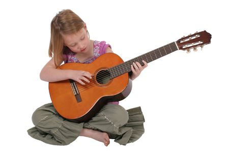 A yound girl playing guitar.