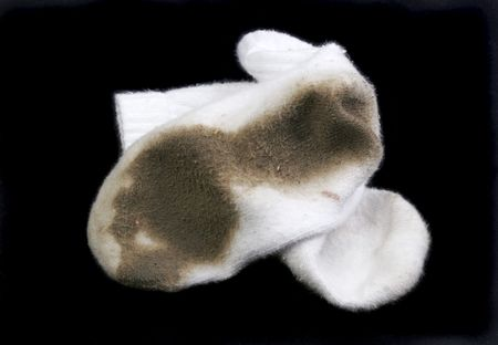 dirty feet: Really dirty white socks worn outside in the dirt.