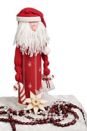 candycane: Toy Santa figurine holding a candycane and gift with decorations below. Stock Photo