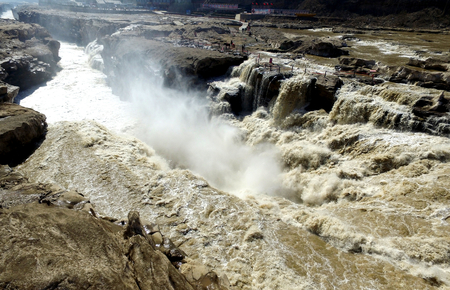 tidal wave: March 03, 2016, the aerial of the Hukou waterfall in Shanxi province and the water goes up in smoke