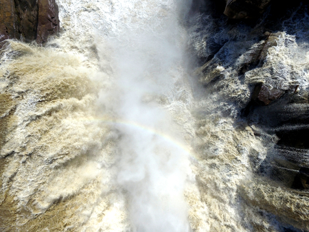 tidal wave: March 03, 2016, aerial smoke and Rainbow in the water of the Hukou waterfall at Shanxi province