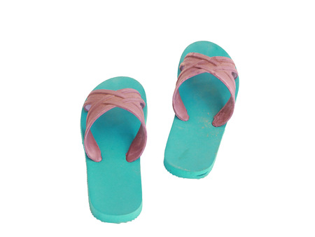 wooden insert: Green and blue rubber slippers on a white background Stock Photo