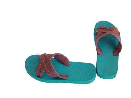 wooden insert: Thai used green and blue rubber slippers on a white background