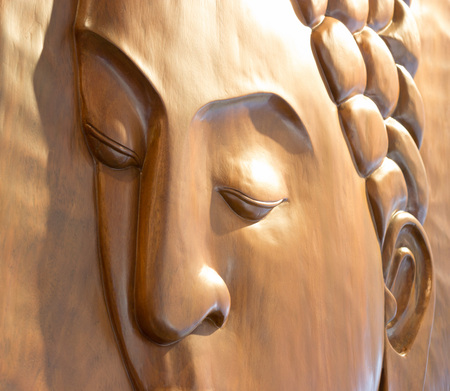 buddha face: Buddha face carved wooden