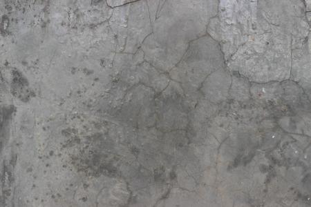 cement floor: Black cracked cement floor