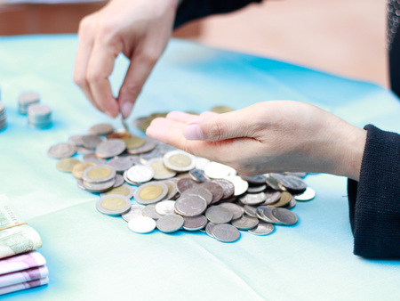counting money: Young woman counting money Stock Photo