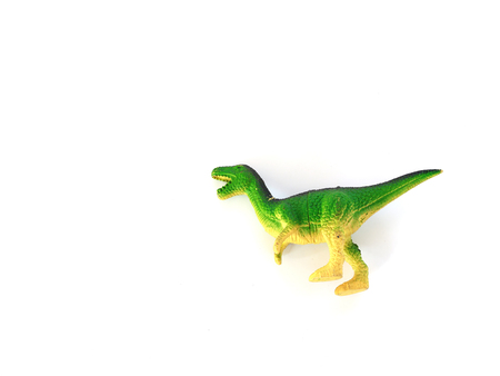 Green dinosaur on a white background Stock Photo