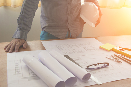construction project: Architectural Office desk background construction project ideas concept, With drawing equipment with sunlight at morning