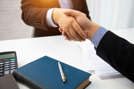 businessman handshake lawyers for consult preparing the phrase to be used in the trial.concept of law