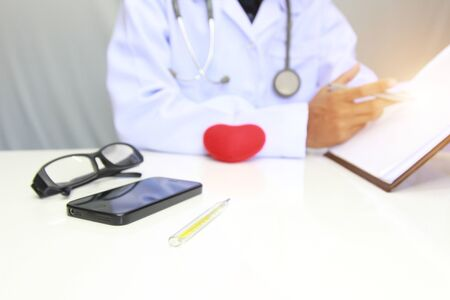 The doctor is recording the patient's medical history for continuous treatment.doctor concept, selective focus