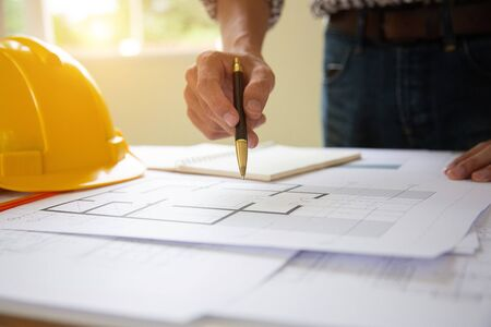Hand engineers are writing home construction designs to bring them to prospective customers.