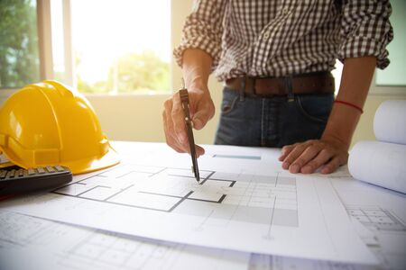 hand Engineers are writing home construction designs to bring them to prospective customers.concept