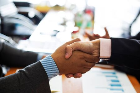 businessman handshake agreement for consult preparing the phrase to be used in the trial.concept of business