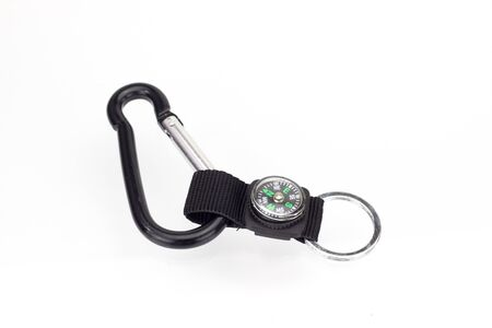 Compass key ring placed on a white background. Stockfoto