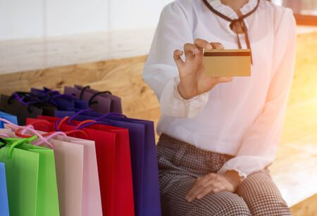 Online Shopping Girls, in office, Shopping concept, soft focus, vintage tone Фото со стока